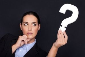 woman holding a question mark